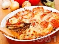 Патладжанова мусака с телешка кайма и заливка от сирене моцарела